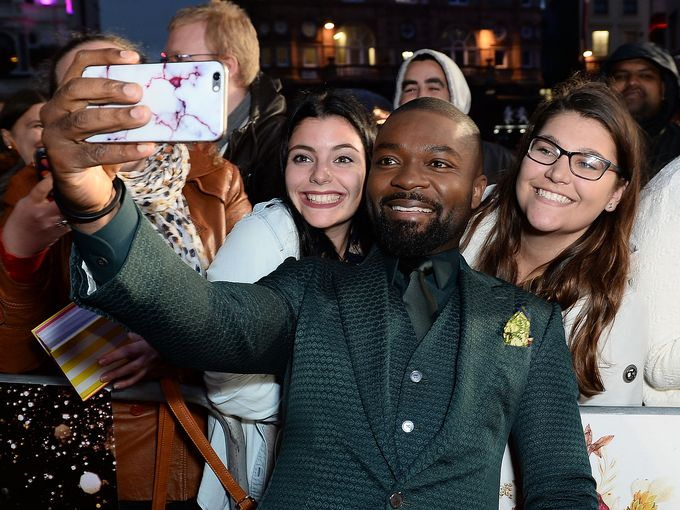 David Oyelowo takes a selfie with fans at the Queen of Katwe screening at the 2016 BFI Film Festival, London.