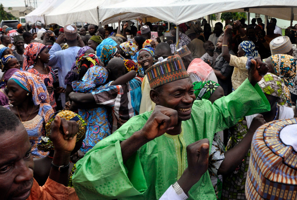 Family members celebrate after being reunited with the kidnapped girls during an church service held in Abuja, Nigeria, Sunday, Oct. 16, 2016.